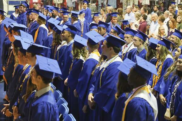 Midland Christian seniors process in 05/25/18 evening during the commencement ceremony at the McGraw Events Center at MCS. Tim Fischer/Reporter-Telegram
