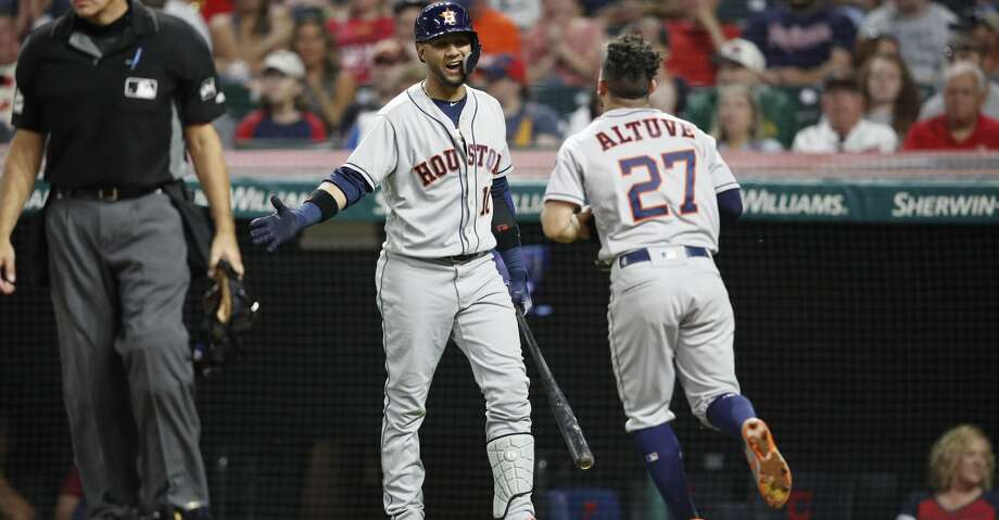 CLEVELAND, OH - MAY 25: Jose Altuve #27 of the Houston Astros celebrates with Yuli Gurriel #10 after scoring the go ahead run in the eighth inning against the Cleveland Indians at Progressive Field on May 25, 2018 in Cleveland, Ohio. (Photo by Joe Robbins/Getty Images) Photo: Joe Robbins/Getty Images