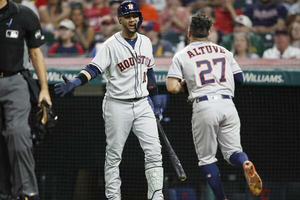 CLEVELAND, OH - MAY 25: Jose Altuve #27 of the Houston Astros celebrates with Yuli Gurriel #10 after scoring the go ahead run in the eighth inning against the Cleveland Indians at Progressive Field on May 25, 2018 in Cleveland, Ohio. (Photo by Joe Robbins/Getty Images)