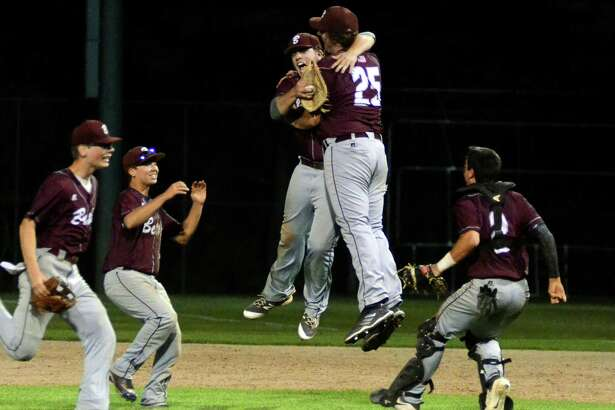Bethel teammates celebrate their win over Newtown during SWC baseball action in Bethel, Conn., on Friday May 25, 2018.