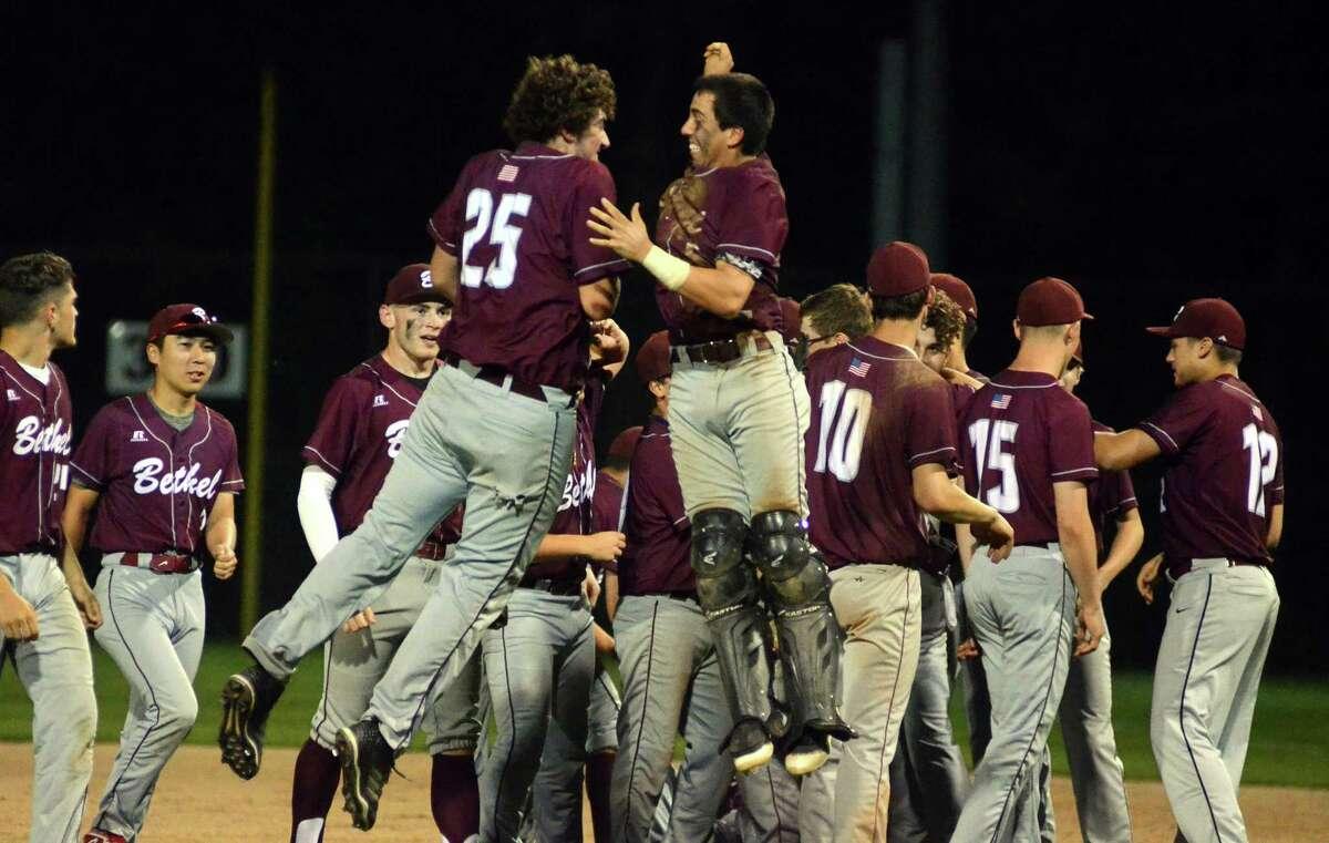 Bethel teammates celebrate their win over Newtown during SWC baseball action in Bethel on Friday.
