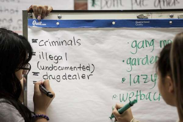 Stereotypes and slurs for Latinos are written on a flip chart during an exercise at Camp Everytown. African Americans, Asian Americans, LGBT students and members of other groups are confronted with such terms in what is meant to be an empathy-building exercise.