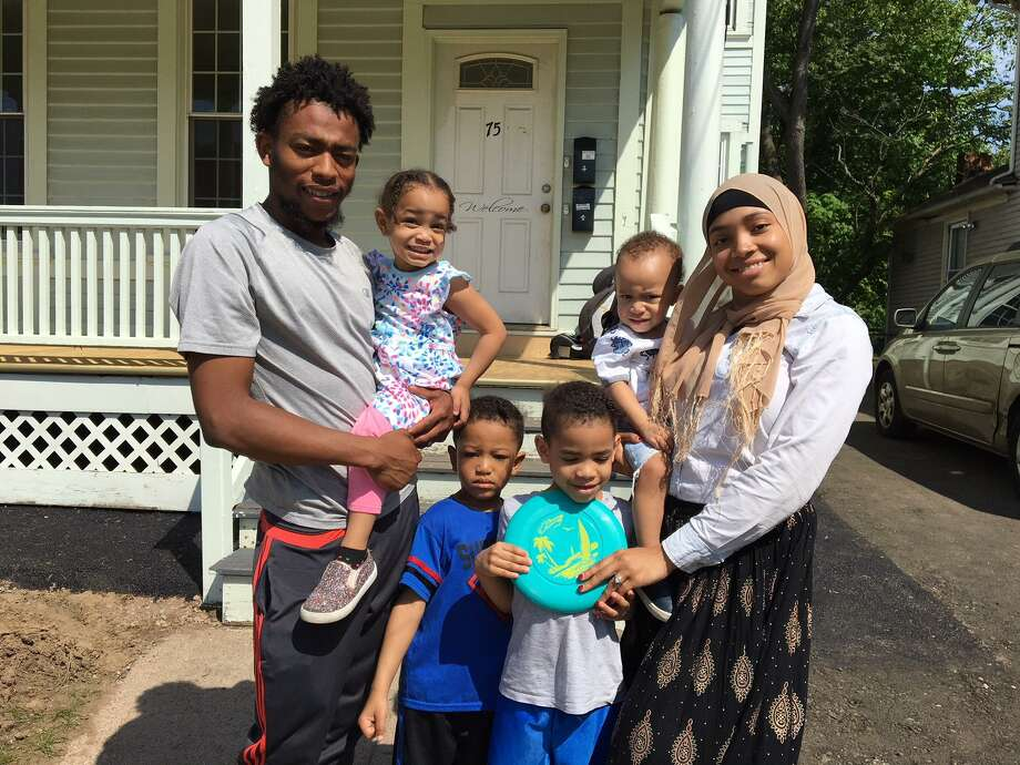 Maajid Muhammad, left, and his wife, Raihana Muhammad, with their children in front of their apartment on Sherman Avenue. They have been living in a hotel until the court agrees that the unit has been properly lead abated. The children range in age from 1 to 5. The youngest, Maalig, has elevated blood lead levels. Photo: Mary E. O'Leary / Hearst Connecticut Media