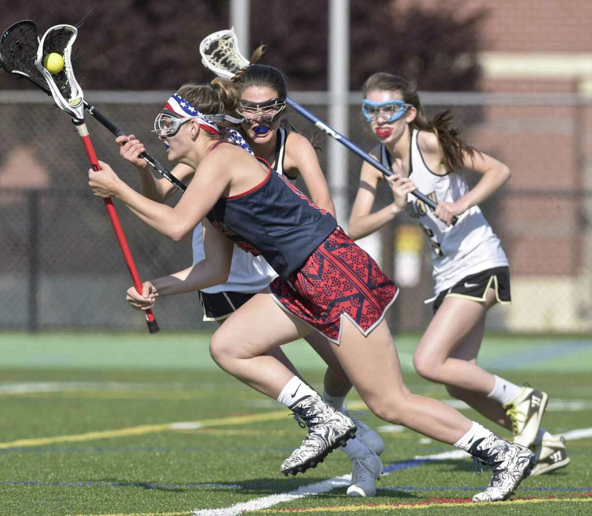 New Fairfield's Alexa Meres (19) goes by Joel Barlow defenders Julia Hartmann (14) and Erin Carroll (6) in the girls SWC lacrosse championship game between New Fairfield and Joel Barlow high schools, Friday afternoon, May 25, 2018, at New Milford High School, New Milford, Conn. New Fairfield defeated Joel Barlow 20-14 to win the SWC girls lacrosse championship.