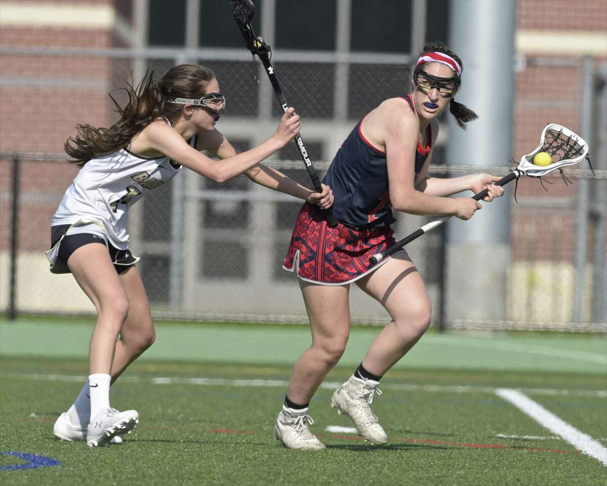 New Fairfield's Reagan Tenaglia (23) is defended by Joel Barlow's Julia Hartmann (14) as she moves with the ball in the girls SWC lacrosse championship game between New Fairfield and Joel Barlow high schools, Friday afternoon, May 25, 2018, at New Milford High School, New Milford, Conn. New Fairfield defeated Joel Barlow 20-14 to win the SWC girls lacrosse championship.