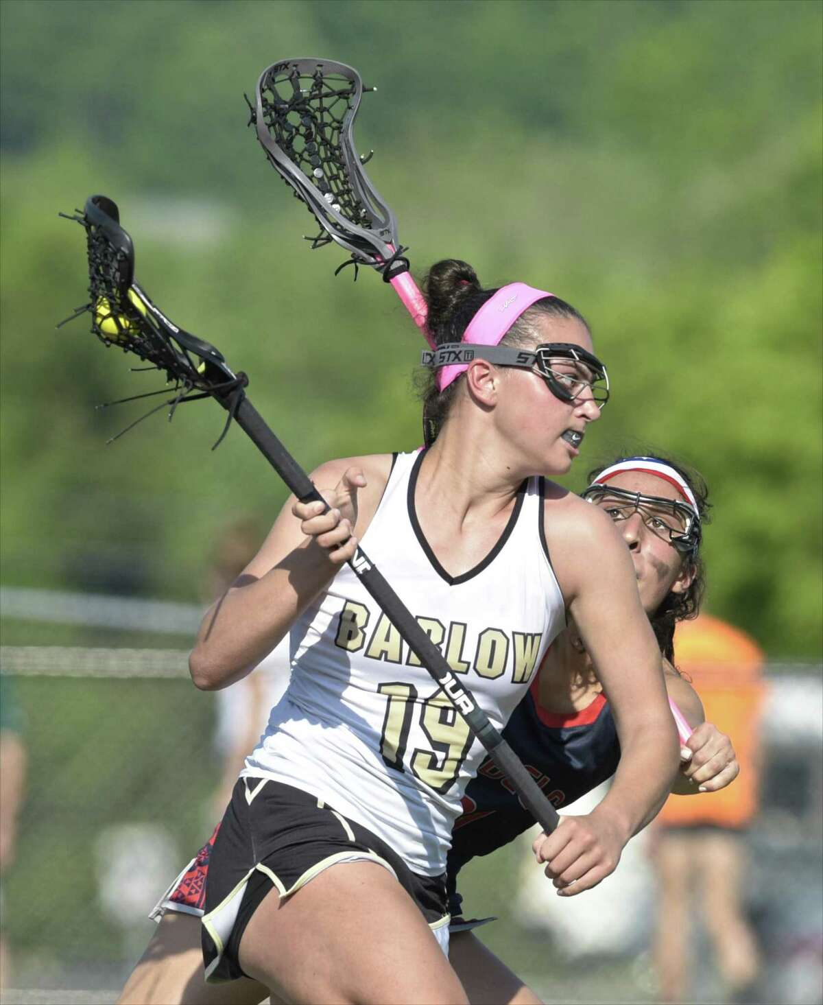 Joel Barlow's Bella Miceli (19) moves with the ball while being defended by New Fairfield's Sophia Kleopaulos (21) in the girls SWC lacrosse championship game between New Fairfield and Joel Barlow high schools, Friday afternoon, May 25, 2018, at New Milford High School, New Milford, Conn. New Fairfield defeated Joel Barlow 20-14 to win the SWC girls lacrosse championship.