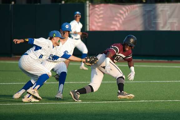 Clear Springs' Michael Gillaspia  (8) runs down Cy-Fair's Casen White (21) Friday, May 25 at the University of Houston.