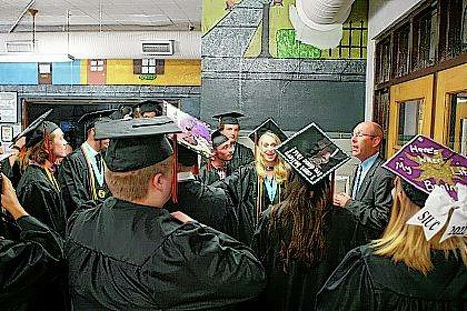 Waverly superintendent Dustin Day addresses the class of 2018 before the graduation ceremony Friday. Photo:       Audrey Clayton | Journal-Courier