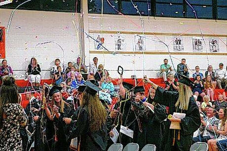 Franklin High School's Class of 2018 celebrates their graduation Friday with confetti and silly string. Photo:     Audrey Clayton | Journal-Courier