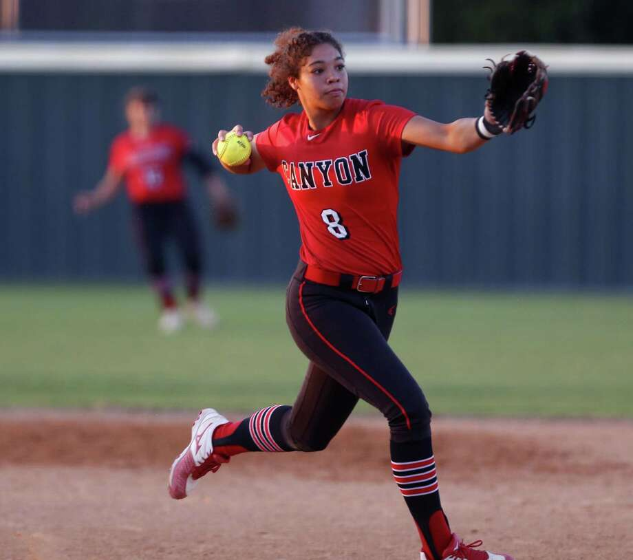 New Braunfels Canyon's Aliyah Pritchett throws out a runner in the Region IV-6A high school softball final between New Braunfels Canyon and Warren at Southwest High School on Friday, May 25, 2018. Photo: Ronald Cortes / / 2018 Ronald Cortes