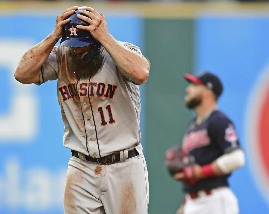 Houston Astros' Evan Gattis reacts after being tagged out at second base by Cleveland Indians' Jason Kipnis in the third inning of a baseball game, Friday, May 25, 2018, in Cleveland. (AP Photo/David Dermer) Photo: David Dermer/Associated Press