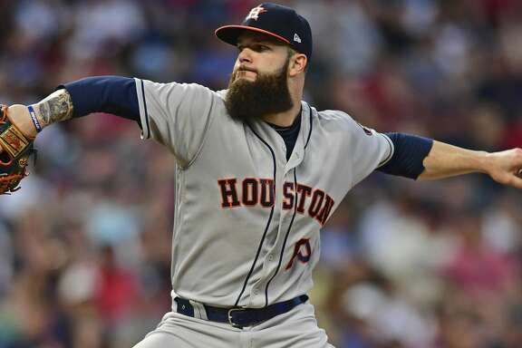 Houston Astros starting pitcher Dallas Keuchel throws during the fifth inning of the team's baseball game against the Cleveland Indians, Friday, May 25, 2018, in Cleveland. (AP Photo/David Dermer)
