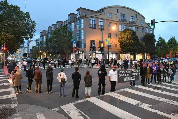 A crowd blocks the intersection of Valencia and 17th during a rally calling for justice for victims shot by police in San Francisco on Friday, May 25, 2018.