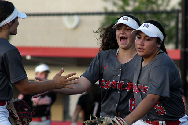 Atascocita freshman pitcher Mikayla Garza, center, celebrates retiring Katy in the top of the 5th inning with teammates Katie Cimusz, left, and Lesly Miranda, right,  during game 2 of their Region III Class 6A regional final series at Crosby High School on May 25, 2018. (Jerry Baker/For the Chronicle)