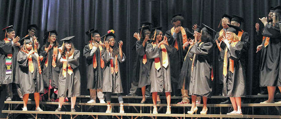 "Members of the Illinois School for the Deaf Class of 2018 perform their class song, ""Powerful"" by Jussie Smollett and Alicia Keyes, during their commencement ceremony Friday. Photo:       Dennis Daniel 