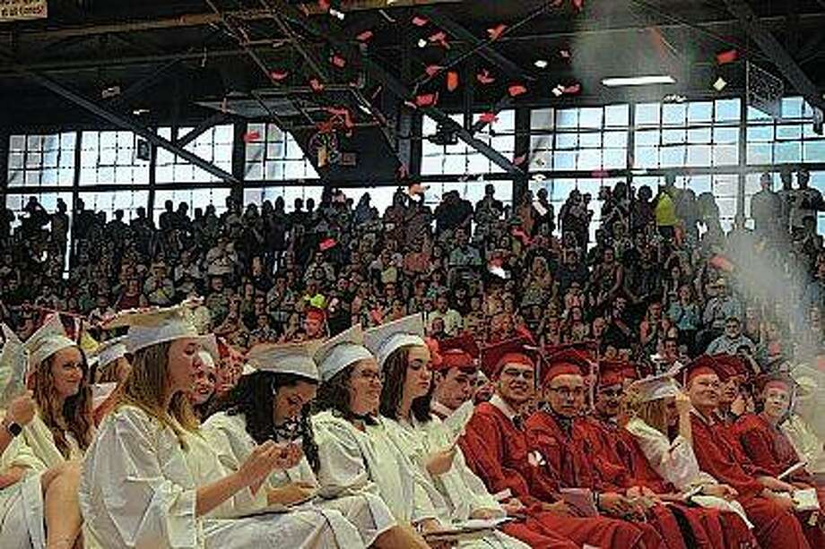 Jacksonville High School class of 2018 members get sprayed with confetti Friday at the end of their commencement ceremony.