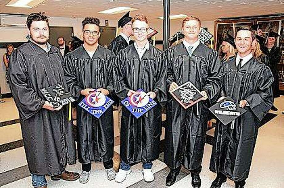 Young men from the Winchester High School Class of 2018 display their mortar board art prior to Friday's graduation. Photo:     By David Blanchette | For The Journal-Courier