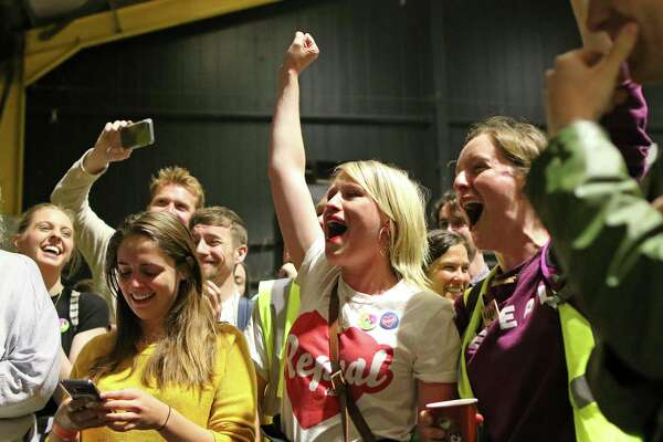 """People from the """"Yes"""" campaign react, as the results of the votes begin to come in the Irish referendum on the 8th Amendment of the Irish Constitution at the RDS count centre, in Dublin, Ireland, Saturday May 26, 2018. Ireland appeared to move away from its conservative Roman Catholic roots and embrace a more liberal view Friday as two major exit polls predicted voters had repealed a constitutional ban on abortion."""