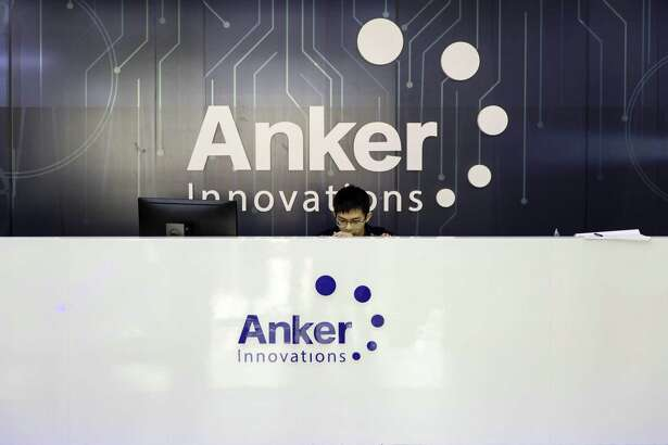 An employee sits in the reception area at the Anker Innovations Technology Co. office in Shenzhen, China, on May 18, 2018.