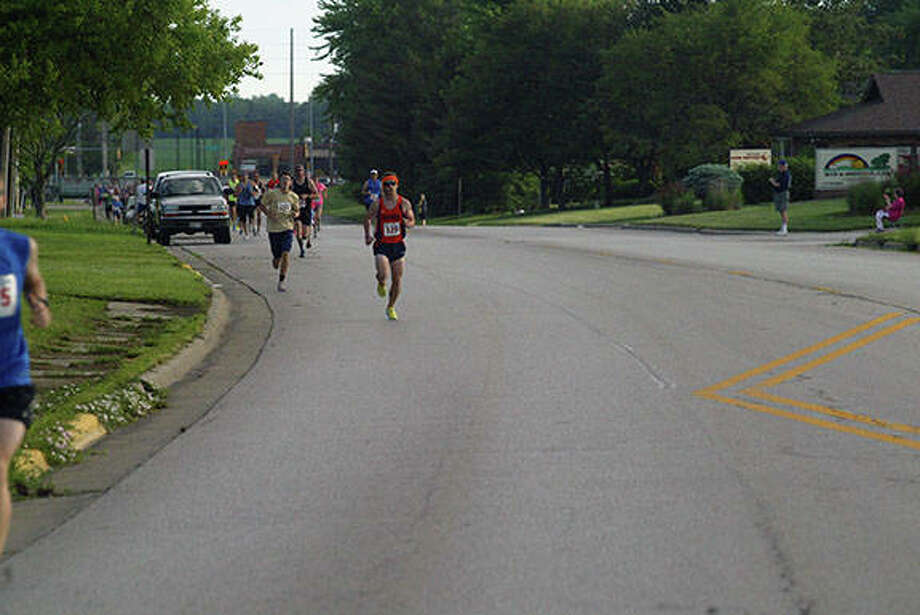 Runners take part Saturday in Passavant Area Hospital Foundation's Passavant-Gatorade 5K-10K Race. It was the 26th year for the race, which attracted about 300 runners this year. Photo:       David C.L. Bauer | Journal-Courier