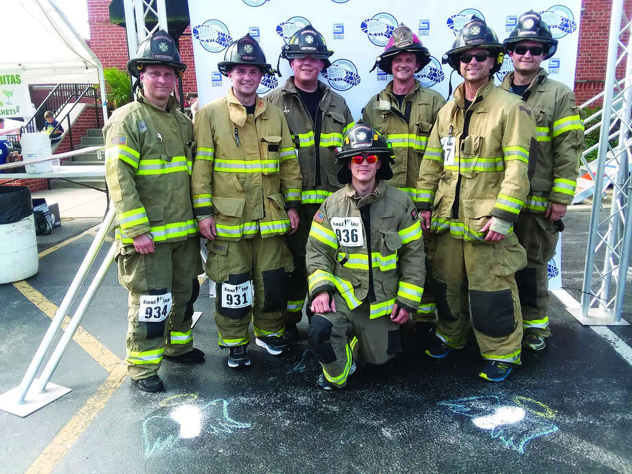 In no order, Edwardsville firefighters Mark Mayfield, Gregg Siggnorotti, Andy Rieger, Tanner Sweetman, Ed Burnley, Doug Moody and Jake Sweetman pose after completing the Run for Bonifest.