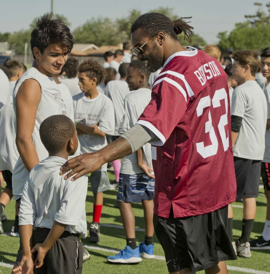 Former LHS standout and professional football player Cedric Benson talks with area players during a break 05/26/18 morning at Lee High practice field during the Cedric Benson Football Camp. Tim Fischer/Reporter-Telegram Photo: Tim Fischer/Midland Reporter-Telegram