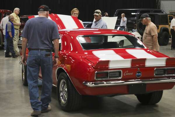 Car enthusiasts, buyers and collectors look at and bid on cars new and old 05/26/18 at the Dan Kruse Classics car auction in the Midland Horseshoe Pavilion. Tim Fischer/Reporter-Telegram