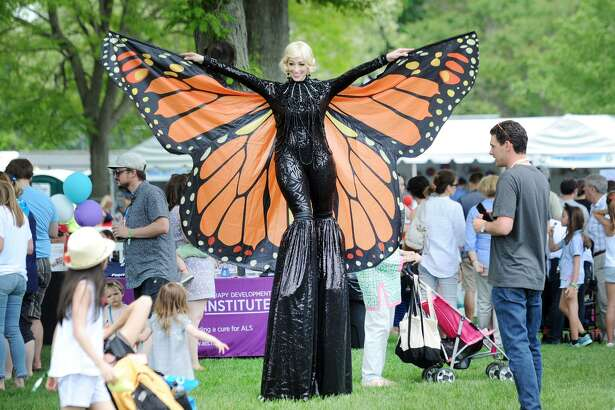 A woman wearing a Monarch butterfly outfit was part of the Greenwich Town Party at Roger Sherman Baldwin Park in Greenwich, Conn., Saturday, May 26, 2018. The annual outdoor concert event and party is in its eighth year and regularly draws more than 8,000 people throughout the day at the waterfront park that overlooks Greenwich Harbor.