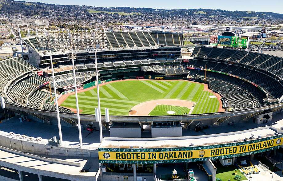 The Oakland Fire Department is investigating whether a one-alarm fire that began Friday evening near the Oakland Coliseum was caused by a fireworks display following the Oakland A's game. Photo: Noah Berger / Special To The Chronicle