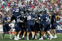 Yale players celebrate after defeating Albany 20-11 in the semifinals of the NCAA Division 1 college lacrosse tournament in Foxborough, Mass., Saturday, May 26, 2018.