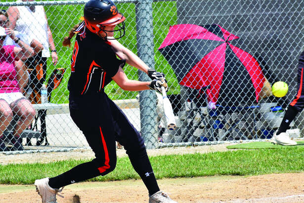 Edwardsville pinch hitter Kay Swanson rips an RBI single up the middle in the sixth inning of Saturday's game against Springfield Sacred Heart-Griffin in Alton.