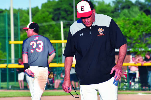 Mike Waldo walks away from the EHS mound for the last time as the Tiger pitching coach after a 39-year career.