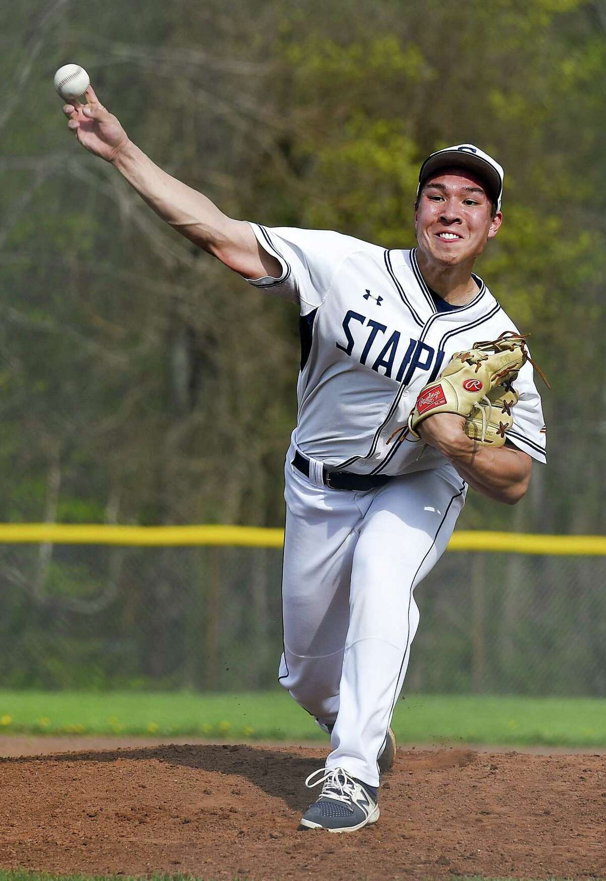 Staples pitcher Chad Knight makes his delivery against Darien in the top of the second inning of a FCIAC baseball game on May 4.