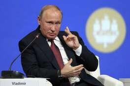 Russian President Vladimir Putin speaks during the St. Petersburg International Economic Forum on Friday.