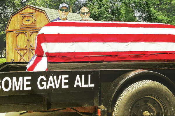 Billy Hammon and Glen Wilson of Alton VFW Post 1308 Ritual Team, along with Royal Ward, created a float with a flag-draped casket on a trailer honoring those who gave their lives in service to the country. The display will be in Monday's, 151st annual Alton Memorial Day Parade.