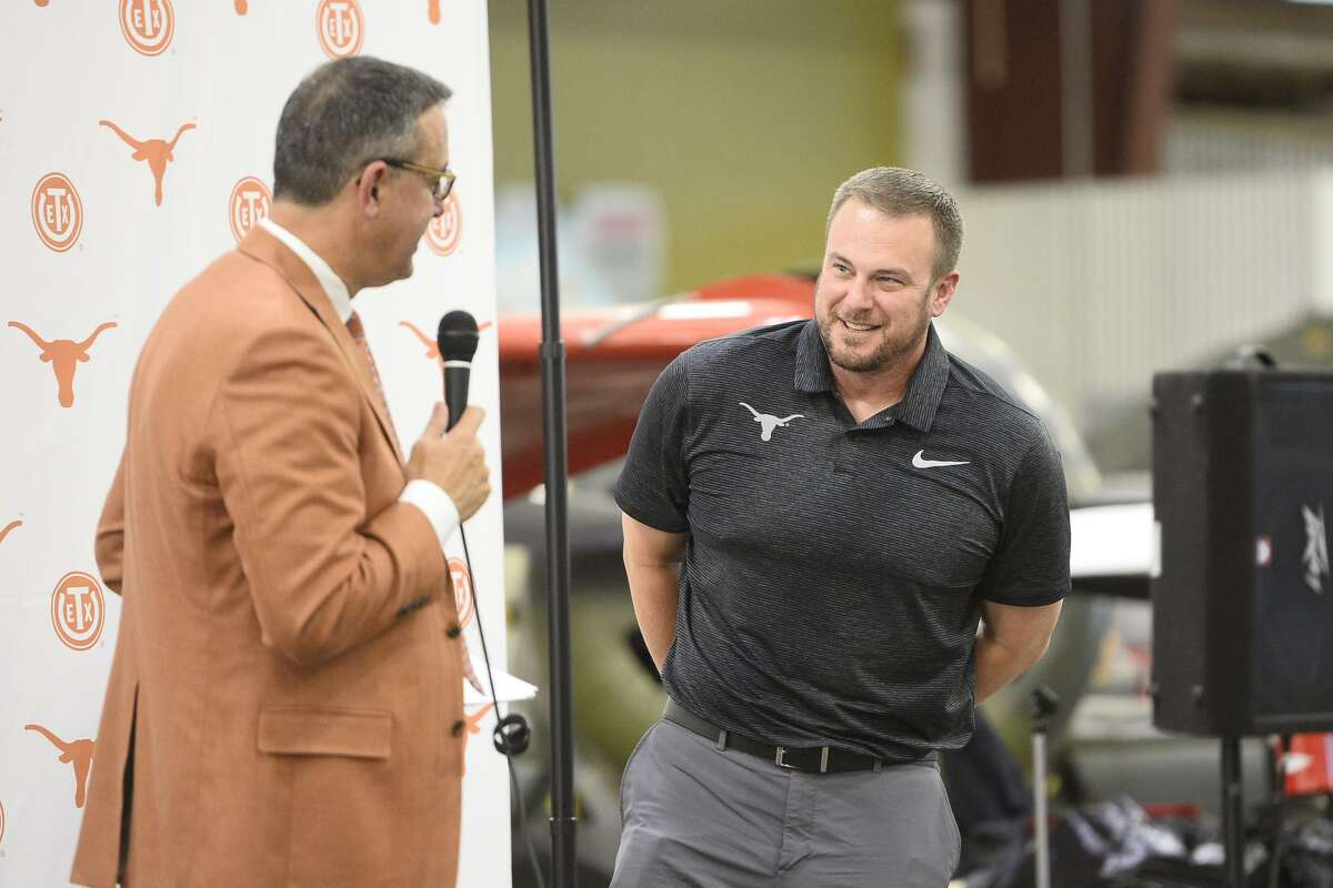 Texas Exes and University of Texas Athletics Department passed through Midland on the This Is Texas Tour featuring athletics program leaders including head football coach Tom Herman, pictured at right, April 24, 2018, at the Commemorative Air Force museum hanger. Pictured at left, Chris Del Conte, athletics director. James Durbin/Reporter-Telegram