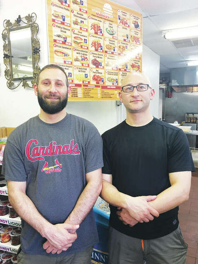 State's Corner Market owners Mohammad, left, and Ghassan Mahmoud invested in the Alton community of which they are proud to be a part, they said. They have worked in the city for three years and decided to open their own business upon seeing the potential for a fresh food, family-owned grocer and eatery in the neighborhood where State's Corner Market is located at 1269 State St., at the corner of Ninth Street, in Alton. Photo:       Jill Moon|The Telegraph