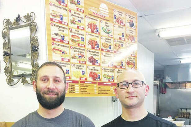 State's Corner Market owners Mohammad, left, and Ghassan Mahmoud invested in the Alton community of which they are proud to be a part, they said. They have worked in the city for three years and decided to open their own business upon seeing the potential for a fresh food, family-owned grocer and eatery in the neighborhood where State's Corner Market is located at 1269 State St., at the corner of Ninth Street, in Alton.