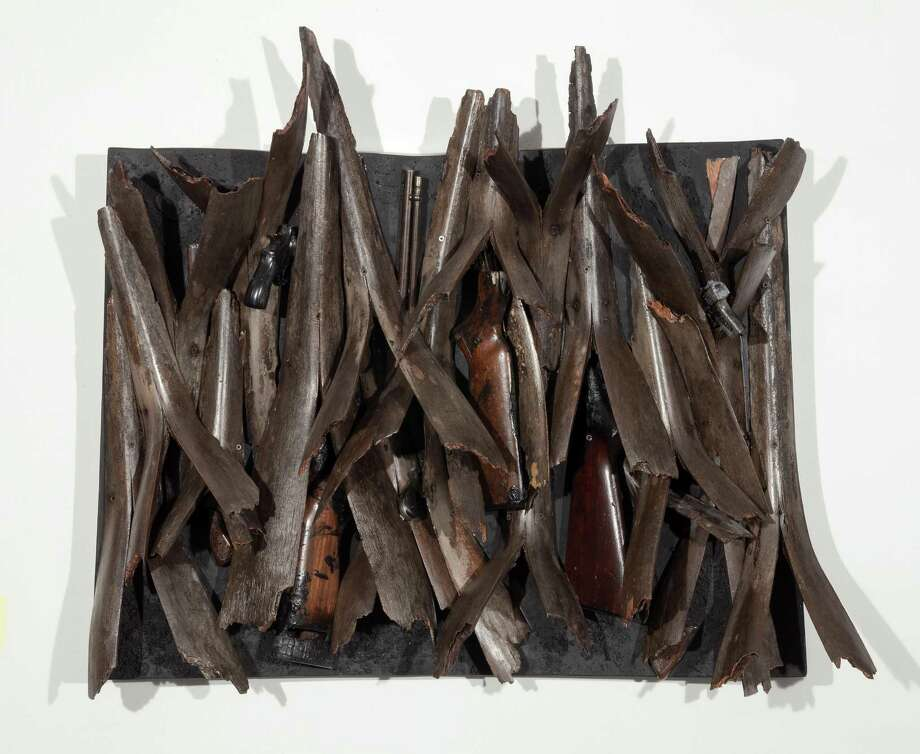 "Ron Bechet's ""Swords to Ploughshares,"" made with palm fronds, gun parts and paint on wood panel. Photo: Mike Smith / Jonathan Ferrara Gallery / Copyright: Michael Smith"