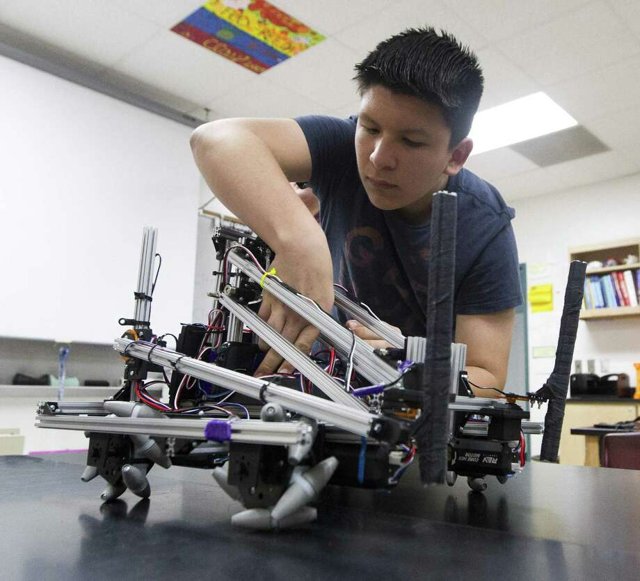 Willis Robotiks member Daniel Perez prepares the team' s robot for a demonstration during class on Wednesday, May 23, 2018, in Willis. The team competed in the UIL State Robotics Championships on May 18 and finished 10th overall. Photo: Jason Fochtman, Staff Photographer / Houston Chronicle / © 2018 Houston Chronicle