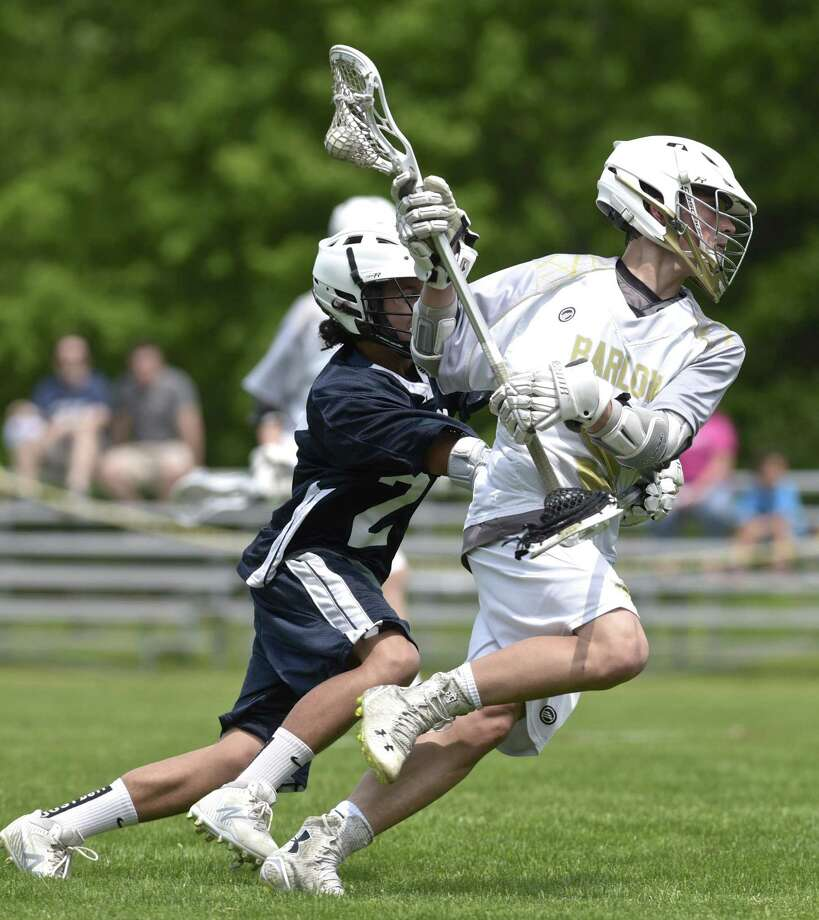 Barlow's Aidan DiMiceli (9) goes past Norwich Tech's Riley Hawkins (2) for a goal in the boys Connecticut Class M lacrosse game between Norwich Tech-Windham Tech and Joel Barlow high schools, Saturday afternoon, May 26, 2018, at Joel Barlow High School, Redding, Conn. Barlow defeated Tech 26-2. Photo: H John Voorhees III / Hearst Connecticut Media / The News-Times