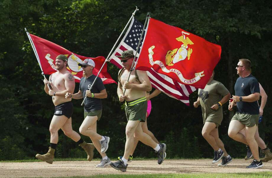 Veterans and community members take part in a formation run during the annual Magnolia Silkies Day and Fun Run in celebration of Memorial Day at Unity Park on Saturday, May 26, 2018, in Magnolia. Photo: Jason Fochtman, Staff Photographer / Houston Chronicle / © 2018 Houston Chronicle