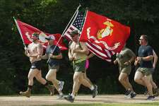 Veterans and community members take part in a formation run during the annual Magnolia Silkies Day and Fun Run in celebration of Memorial Day at Unity Park on Saturday, May 26, 2018, in Magnolia.