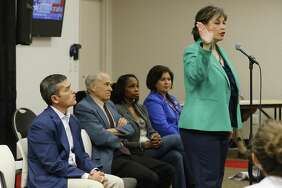 Cynthia Brehm (right) addresses an audience in a mayoral candidate forum hosted by the North East Bexar County Democrats at Tri-Point on Saturday, Apr. 4, 2015.