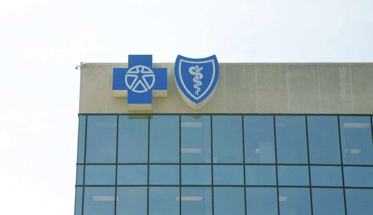 The state's largest insurer will delay its controversial emergency room review process for 60 days as the Texas Department of Insurance asks for more clarity.