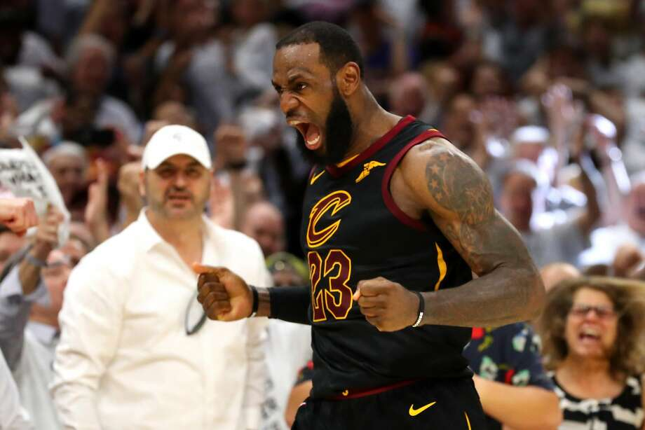 16ffbc729000 The Cavaliers  LeBron James reacts after making a basket in the fourth  quarter of Game