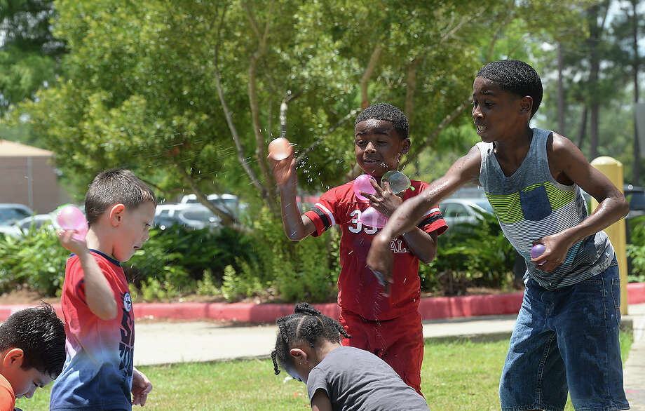Children get into a water balloon fight as they enjoy the activities at the Beaumont Teachers Association blowout bash at Rogers Park. Photo taken Saturday, May 26, 2018 Kim Brent/The Enterprise Photo: Kim Brent / BEN