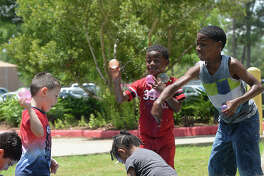 Children get into a water balloon fight as they enjoy the activities at the Beaumont Teachers Association blowout bash at Rogers Park. Photo taken Saturday, May 26, 2018 Kim Brent/The Enterprise