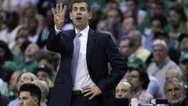 Boston Celtics coach Brad Stevens gestures to his team during the first quarter of Game 5 of the NBA basketball Eastern Conference finals against the Cleveland Cavaliers, Wednesday, May 23, 2018, in Boston. (AP Photo/Charles Krupa)