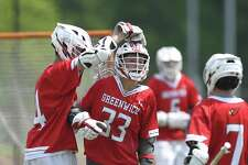 Greenwich Leo Johnson (33) celebrates a second half goal against Shelton in a CIAC Class L boys lacrosse qualifier game at Trumbull High School on May 26, 2018 in Trumbull, Connecticut.